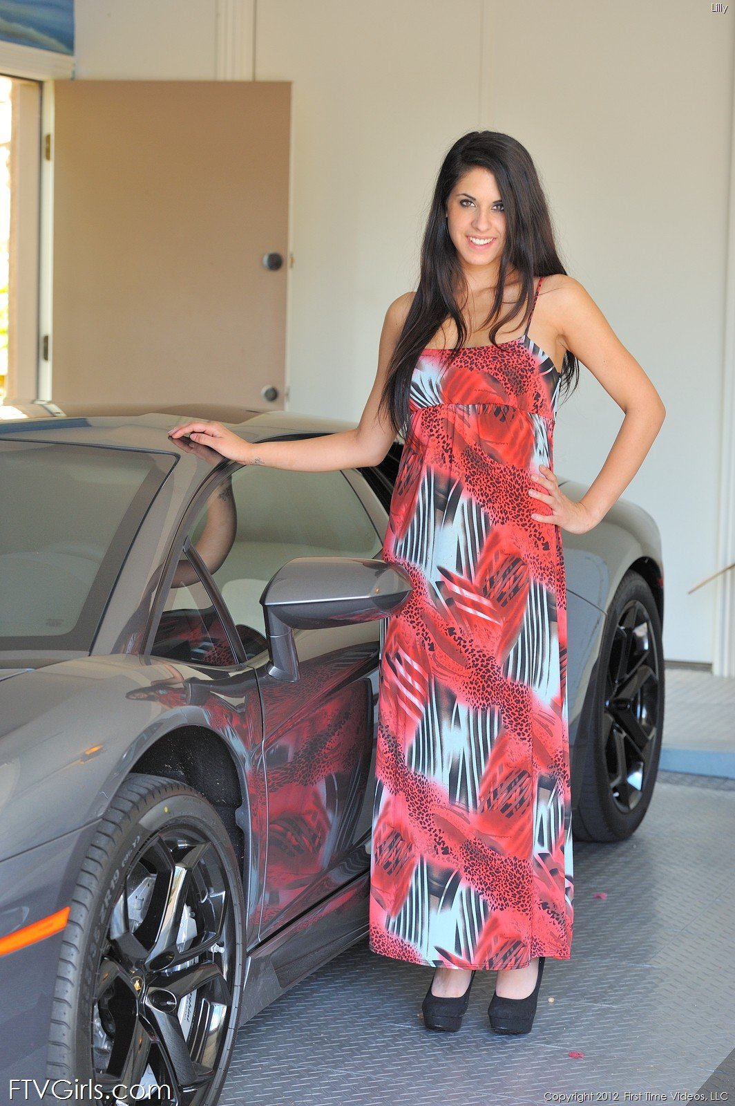 Dark-haired beauty in a long dress shows her natural boobs