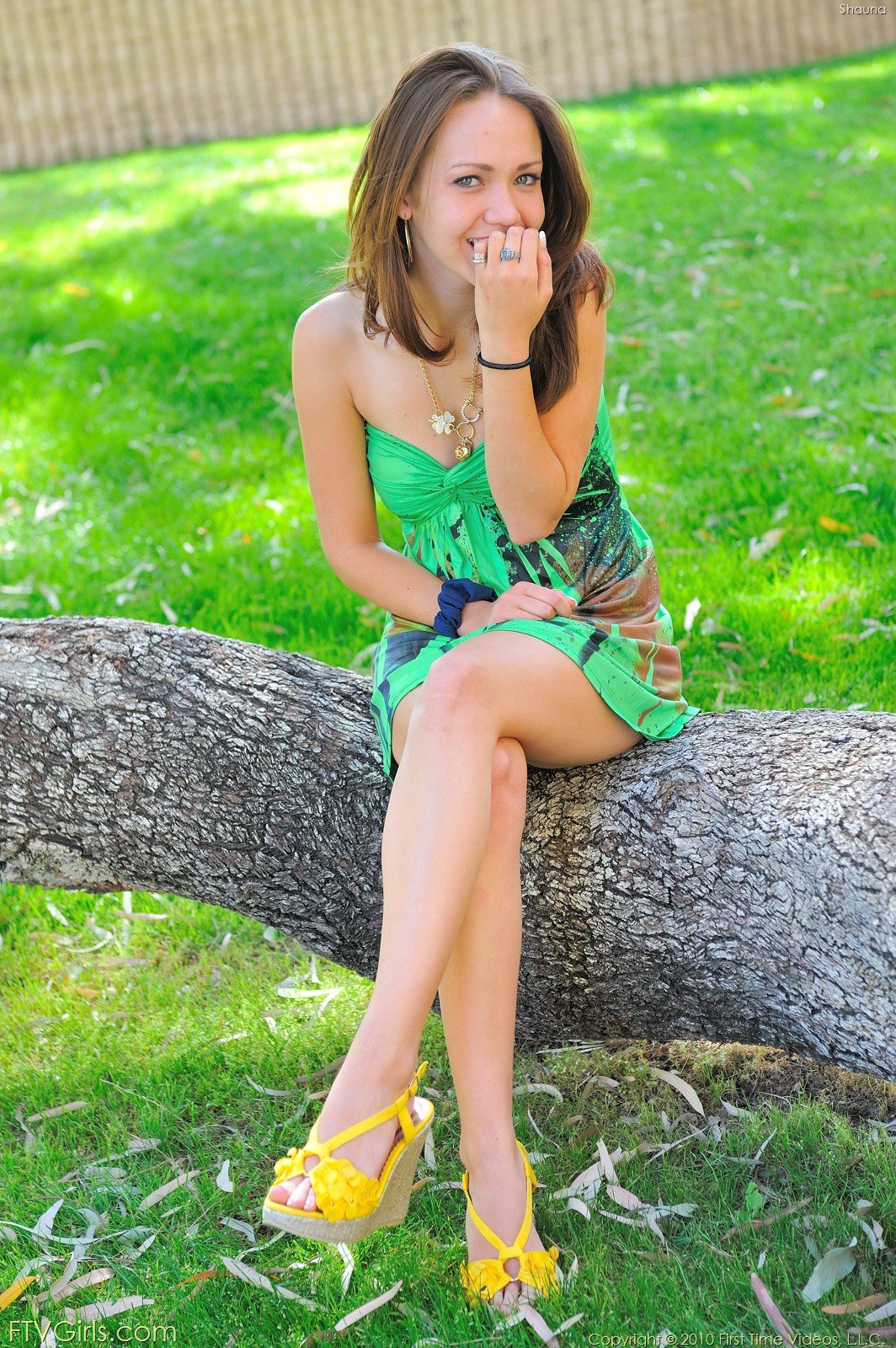 Brown-haired chick in a colorful outfit playing with her