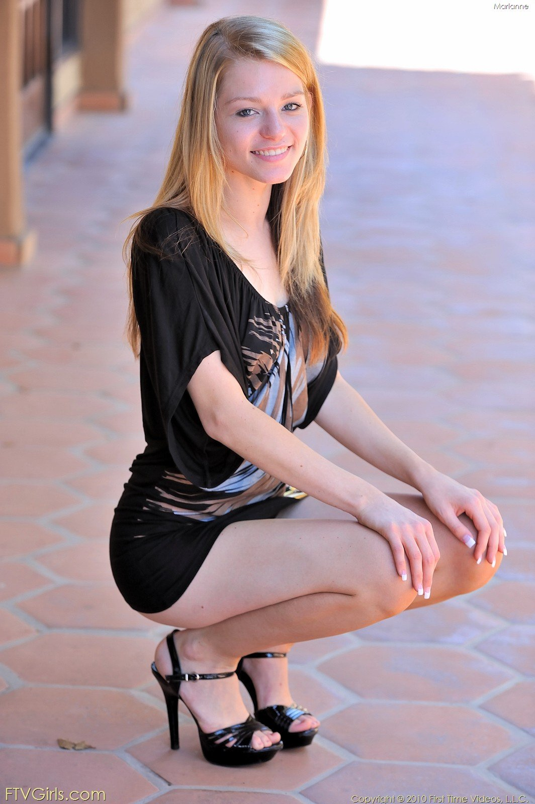 Pristine teen with long legs shows off her enviable body