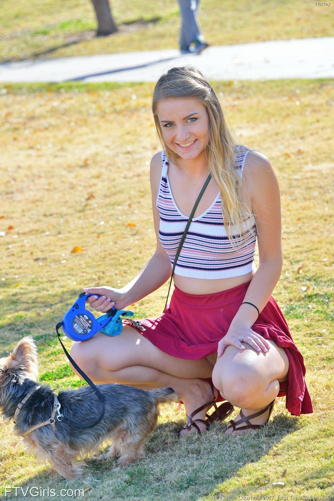 Skirt-wearing blondie with blue eyes teasing her pussy